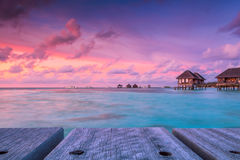 Wonderful twilight time at tropical beach resort in Maldives Royalty Free Stock Photo