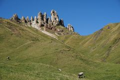 Wonderful view of alp de siusi with distinctive dolomite mountain peak Royalty Free Stock Photo