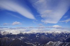 Wonderful view of the Alps. Panoramic view of a winter mountain landscape with blue sky and  clouds Royalty Free Stock Photography