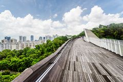 Wonderful view of amazing bridge imitating a wave, Singapore. Wonderful view of amazing bridge imitating a wave. Fantastical shape of the pedestrian bridge in Stock Photo