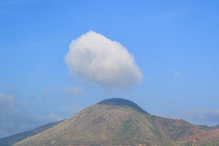 Wonderful view of big cloud over top of mountain. Royalty Free Stock Photos