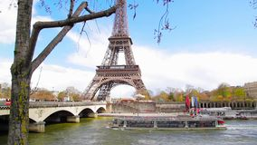Wonderful view on Eiffel tower, cruise boat and bridge stock footage