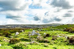 Wonderful view of a hill in the Burren with limestone rocks among the green grass. Geoparks and Geosite, Wild Atlantic Way, beautiful spring day in County royalty free stock photography