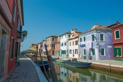Walking through the streets of Burano. Colorful houses. Stock Photo