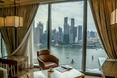 A wonderful view on Marina Bay and Singapore`s Business District form a comfort on king room in Marina Bay Sands Hotel royalty free stock photography