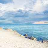 Hollyday nearby sea - Mediterranean Seashore. Wonderful view on the mediterranean sea with purple skies stock images