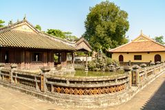 Wonderful view of the Meridian Gate to the Imperial City with the Purple Forbidden City within the Citadel in Hue, Vietnam. Hue is a popular tourist stock photography