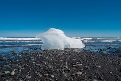 Wonderful view of oceanic black sand beach with ice from Glacier Lagoon, Jokulsarlon, Iceland, summer time, sunny day stock photography