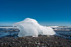 Wonderful view of oceanic black sand beach with ice from Glacier Lagoon, Jokulsarlon, Iceland, summer time, sunny day stock photo