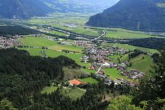 View over the mountains and villages in Austria in the summer. A wonderful view over the mountains and some villages in the valley from above in Austria on a royalty free stock image