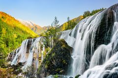 Wonderful view of the Pearl Shoals Waterfall and woods at sunset. Wonderful view of the Pearl Shoals Waterfall among scenic wooded mountains and evergreen forest royalty free stock photos