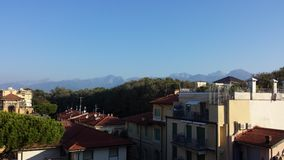 Viareggio. Wonderful view of roofs of viareggio with the alps in the background, taken in summer royalty free stock photos