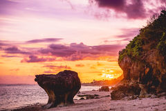 Wonderful warm sunset, rocks, sand beach and ocean in Bali. Wonderful warm sunset, rocks, beach and ocean in Bali stock photo