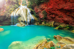 Wonderful waterfall with colorful tree in thailand Stock Image