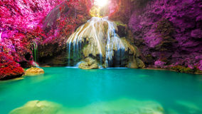 Wonderful waterfall with colorful tree in thailand Stock Photo
