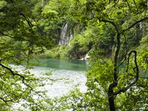 Wonderful waterfall with a lagoon and lake. In the middle stock image