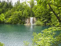 Wonderful waterfall with a lagoon and lake. In the middle royalty free stock photography