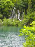 Wonderful waterfall with a lagoon and lake. In the middle stock photos