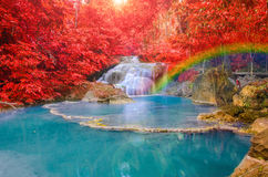 Wonderful Waterfall with rainbows in deep forest at national park. Wonderful Waterfall with rainbows and red leaf in Deep forest at Erawan waterfall National stock images