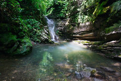 Wonderful waterfall among the rocks in mountain forest. Wonderful waterfall among the rocks in a mountain forest Stock Photography