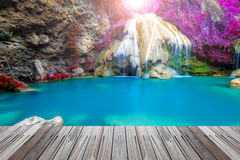 Wonderful waterfall in thailand  with wooden floor Stock Photos