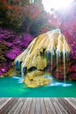 Wonderful waterfall in thailand  with wooden floor Royalty Free Stock Photos