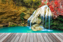 Wonderful waterfall in thailand  with wooden floor Royalty Free Stock Image