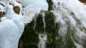 Wonderful waterfall in winter time with traces of ice melting in pure mountain environment, ULTRA HD 4k,real time. Wonderful waterfall in winter time ,ULTRA HD stock video
