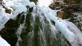 Wonderful waterfall in winter time with traces of ice melting in pure mountain environment, ULTRA HD 4k,real time. Wonderful waterfall in winter time ,ULTRA HD stock footage