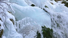 Wonderful waterfall in winter time with traces of ice melting in pure mountain environment, ULTRA HD 4k,real time. Wonderful waterfall in winter time ,ULTRA HD stock video footage