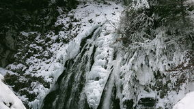Wonderful waterfall in winter time with traces of ice melting in pure mountain environment, ULTRA HD 4k,real time