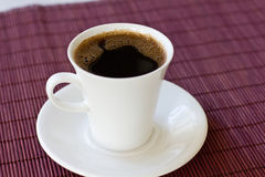 Wonderful white cup with hot black coffee Stock Image