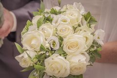 Wonderful white wedding flowers with many jewels and roses. The beautiful flowery accessory of the bride when she will marry her groom. Beautiful decoration Royalty Free Stock Image