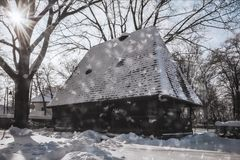 Wonderful Winter Day at the Village Museum in Bucharest. Snowing on a wonderful winter day at the Village Museum in Bucharest. This ethnographic museum is an Royalty Free Stock Photos