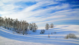 Wonderful winter landscape with beautiful clouds and shadows Royalty Free Stock Images