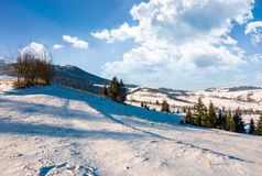 Wonderful winter landscape in mountains. Lovely rural scenery with snowy slopes on a bright sunny day Stock Photography