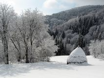 Wonderful winter landscape. Winter wonder. Haystack covered with snow in the background winter mountain landscape.  Carpathian mountains (Karpaty) in Ukraine Stock Photography