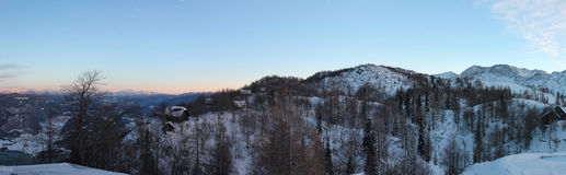 Wonderful winter panoramic view on snowy mountains in sunset blue sky Royalty Free Stock Images