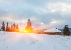 Wonderful winter scenery with snow and timber home Stock Photos