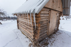 Wonderful winter scenery with snow and timber home Royalty Free Stock Photos