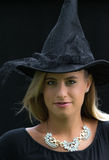 Wonderful witch. A smiling girl with witch hat for Halloween Stock Image