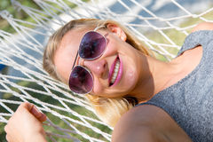 Wonderful woman in a hammock Stock Images
