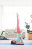 Wonderful woman practicing yoga while standing on shoulders Stock Photos