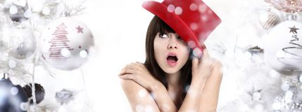 Wonderful woman surprised on Christmas background with balls and Stock Photo