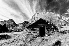 The little house of Santa Claus under the mountains in black and white stock image