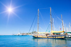 Wonderful yacht in blue bay near Bodrum town. Stock Photos
