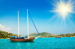 Wonderful yachts and sunbeams in the bay. Royalty Free Stock Photography