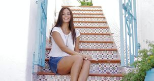 Wonderful young girl posing in summer city stock footage