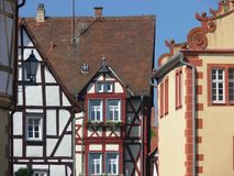 Wonderfully renovated houses from the Middle Ages. Fachwerkhaus in south germany, medieval architecture, medieval style, Truss façade with single window and stock images