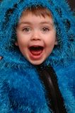 Wondering. Kid being wondering in blue fur coat Royalty Free Stock Image
